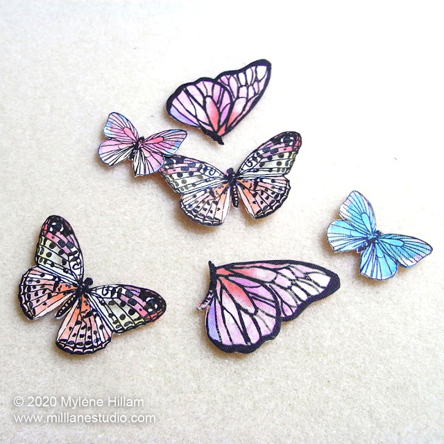 Cut out butterflies ready for coating with resin