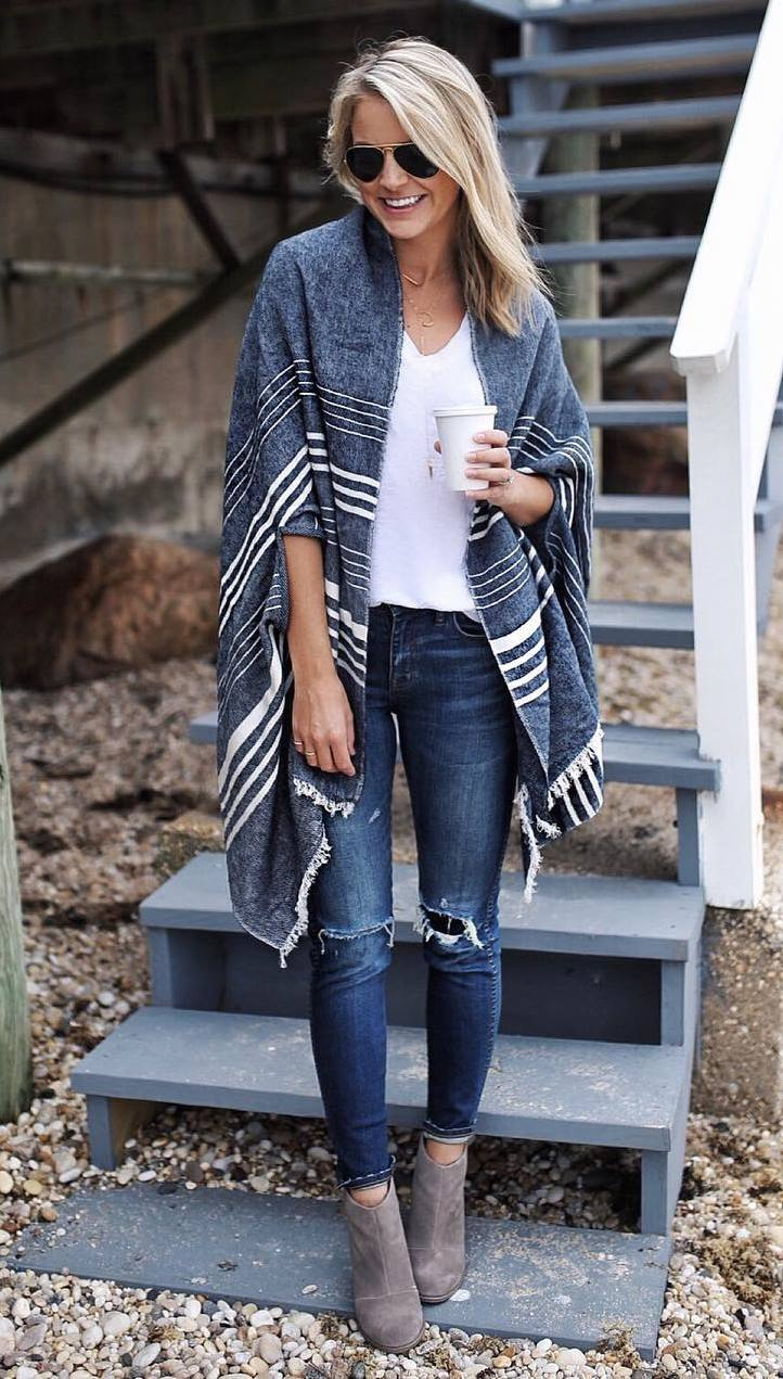 how to wear a striped poncho : white top + skinnies + boots