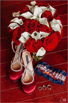 red and white bouquet and wedding shoes