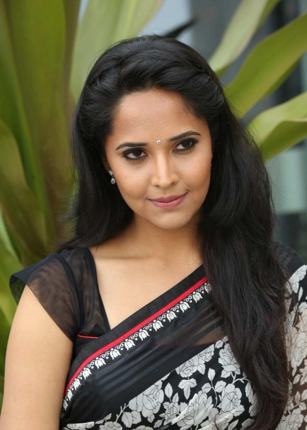 Telugu TV Anchor Anasuya Latest Stills In White Saree