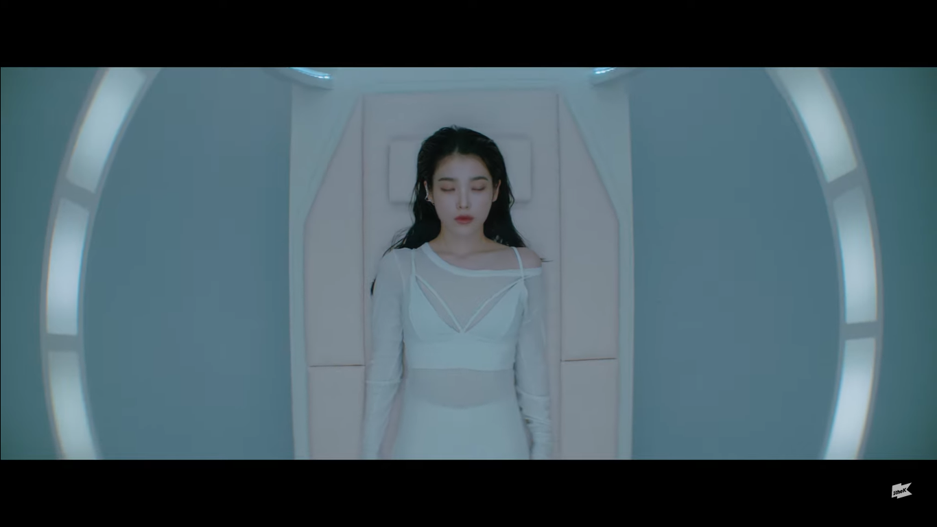 IU Laying and Close Her Eyes in the Futuristic Space in the Teaser MV 'Eight' Feat. Suga of BTS