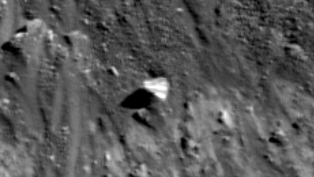 Triangle UFO in a crater on the Moon.