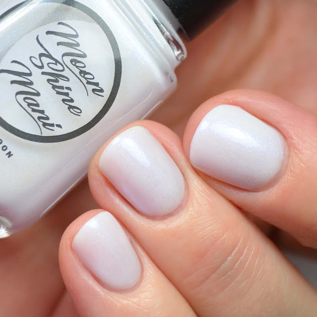 white nail polish with blue shimmer swatch
