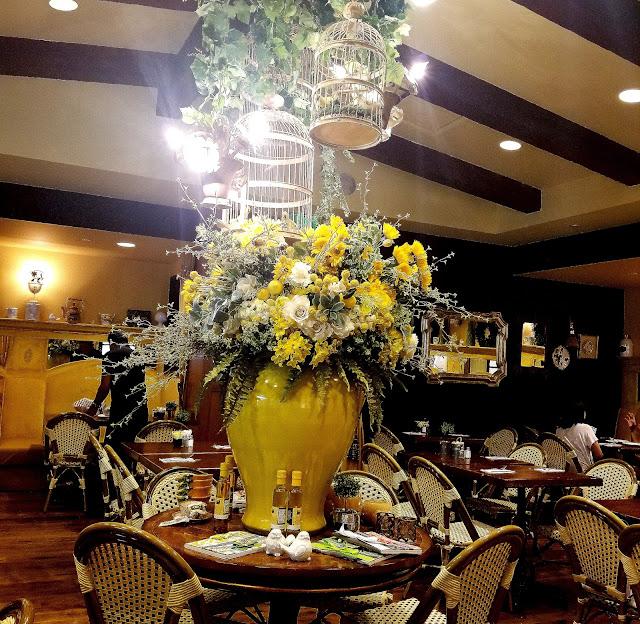 Yellow Vase Cafe South Coast Plaza Orange County California flowers sunflowers French restaurant bird cage