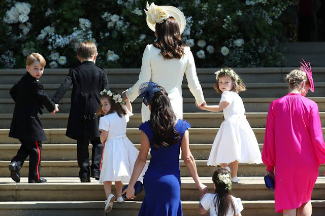 Princesa Charlotte e príncipe William no casamento de Harry e Meghan Markle