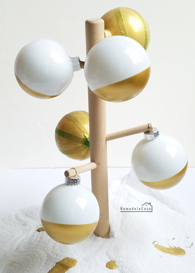Christmas balls drying on mug rack