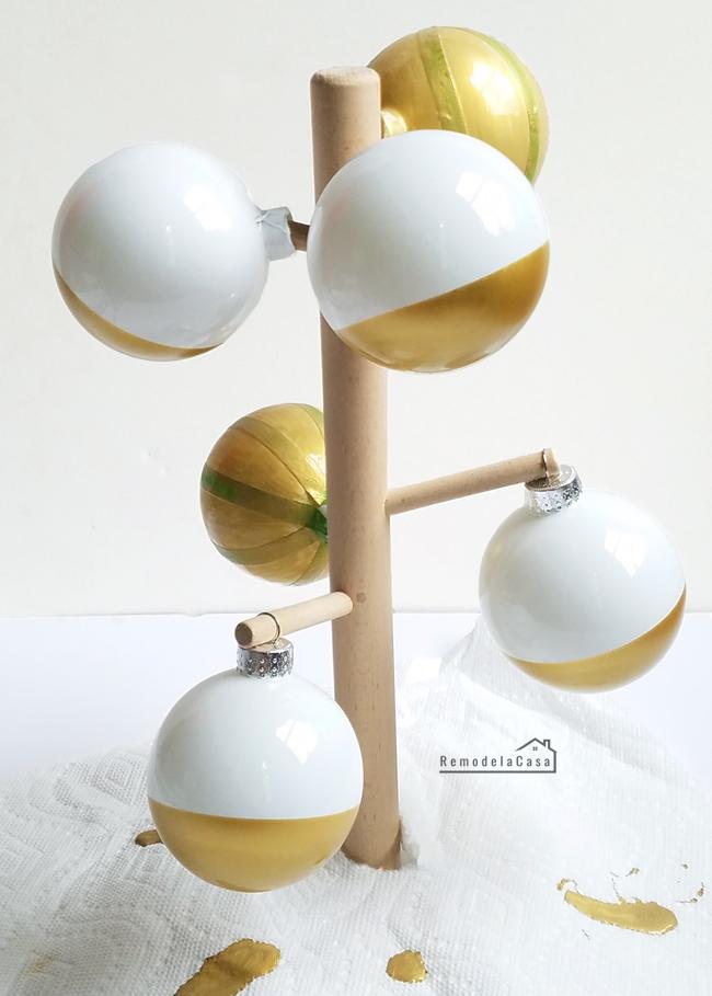 Christmas balls drying on mug rack