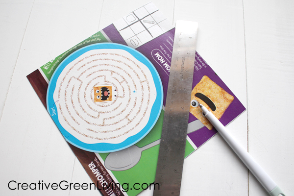 Supplies that you need to make a DIY envelope - empty box, ruler, scoring stylus, scissors
