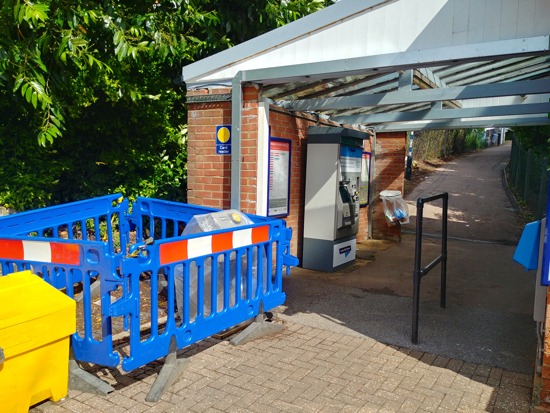 Contactless card reader being installed at Brookmans Park Station