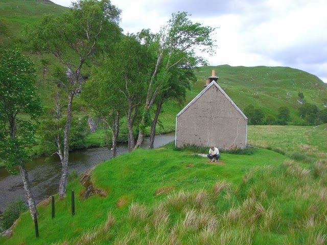 A bothy next to a river in Scotland