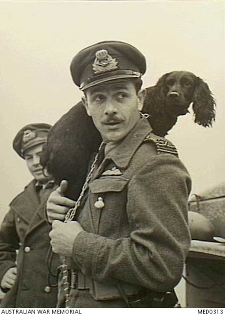 Greek pilot with his dog in the Western Desert, 4 February 1942 worldwartwo.filminspector.com