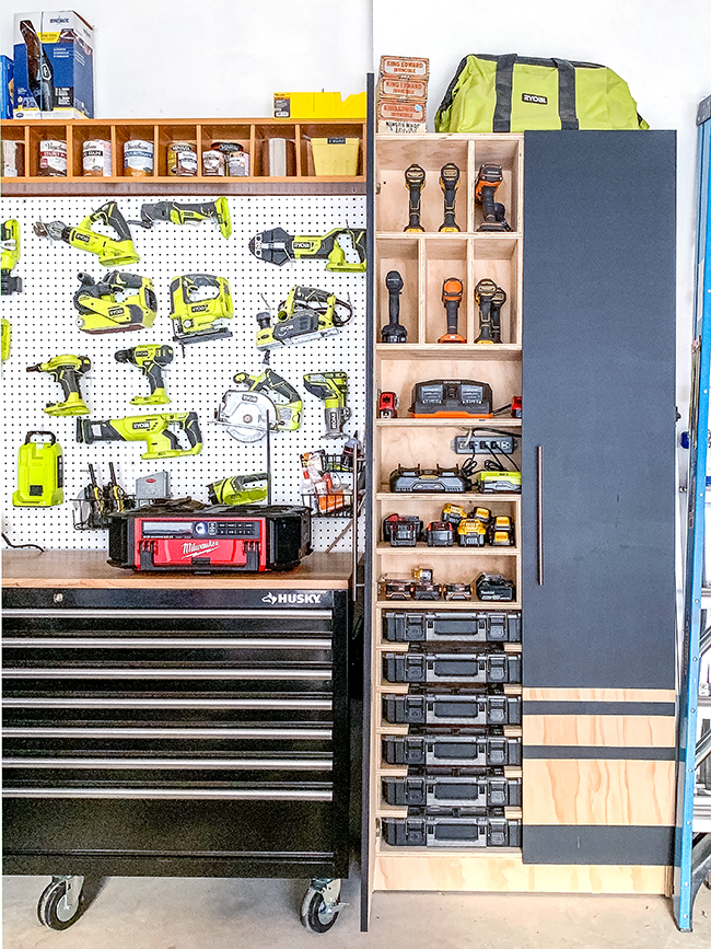 Garage organization with drill charging station, pegboard and Husky mobile workbench