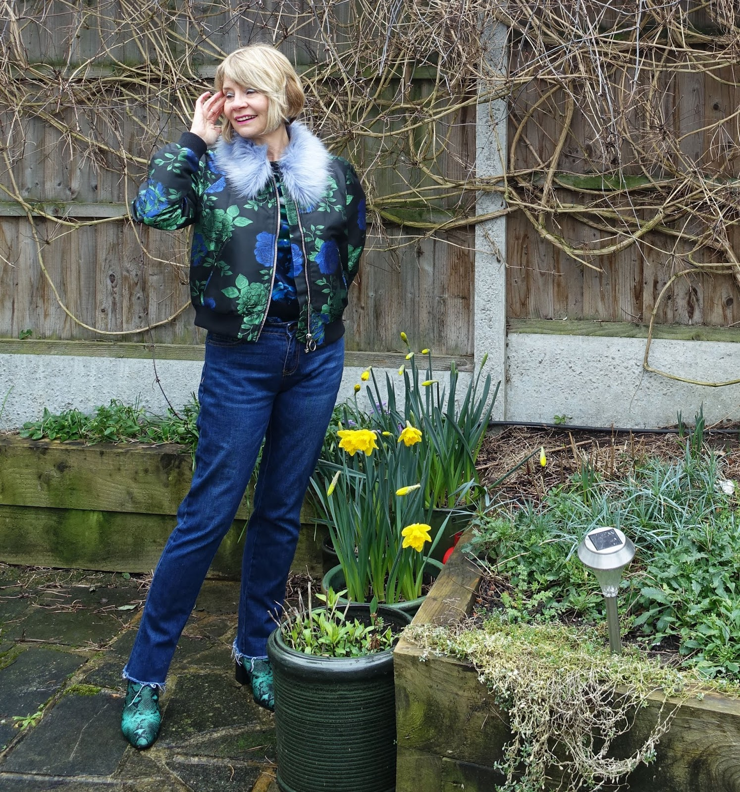 Floral brocade bomber jacket with jeans and green snakeskin boots