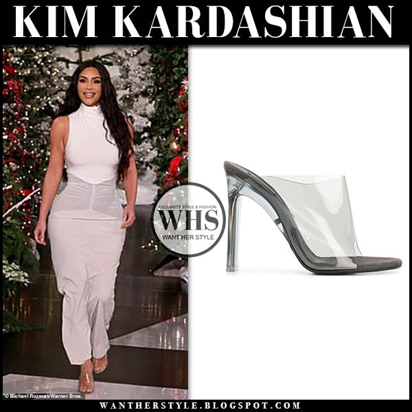 Kim Kardashian in white high neck sleeveless dress and transparent PVC YEEZY mules on Ellen show december 16