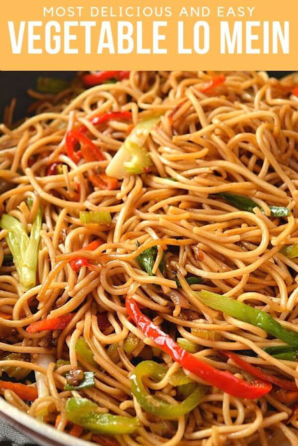 a close look of vegetable lo mein with spring onion,carrots,celery and bell peppers