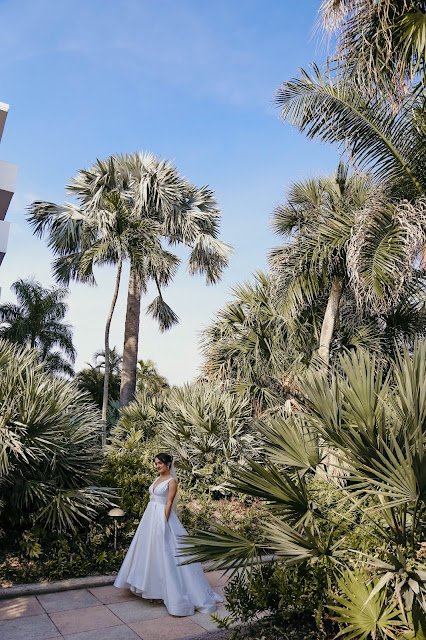 bride with palms at naples beach hotel