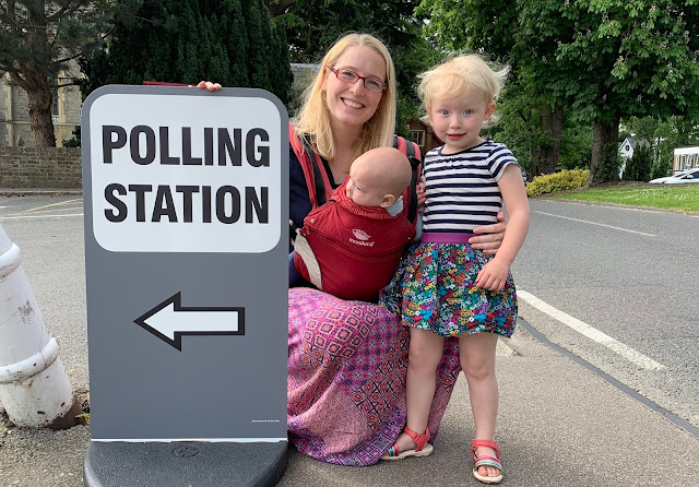 Me and my youngest two children next to a polling station sign after voting in the european elections