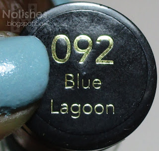 Label shot of Revlon 'Blue Lagoon' - a soft powder blue nail polish with a silver shimmer