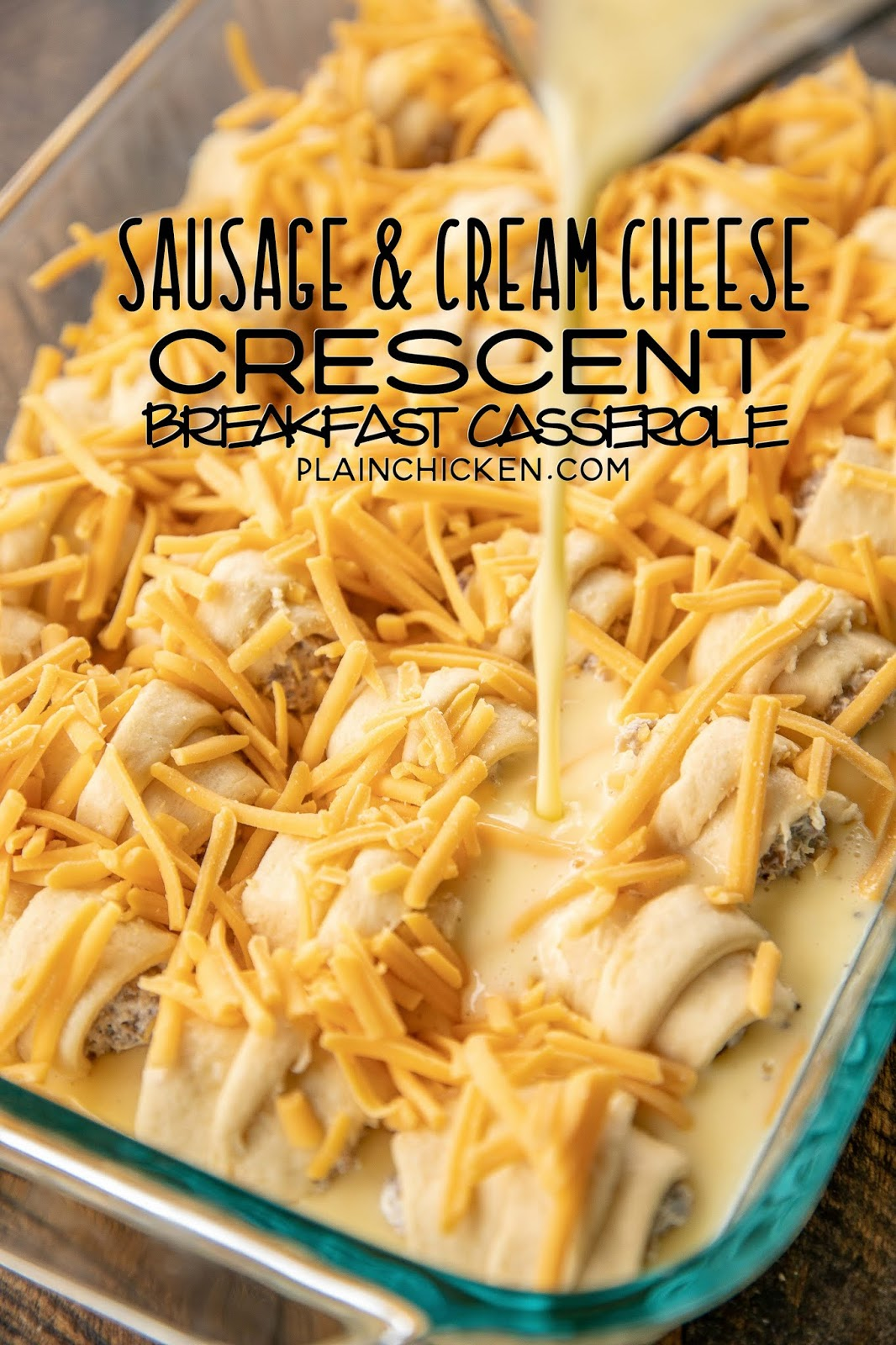 Sausage & Cream Cheese Crescent Breakfast Casserole - the BEST breakfast casserole in the world!!! Crescent rolls stuffed with sausage and cream cheese then topped with an egg mixture and bake. All of my favorites in on dish!!! Can make in advance and bake the next morning. Crescent rolls, sausage, cream cheese, cheddar cheese, eggs, milk, salt and pepper. Everyone LOVES this easy breakfast casserole! #breakfast #breakfastcasserole #casserole #sausage #recipe