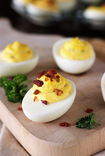 Deviled Eggs Garnished with Crumbled Bacon Image