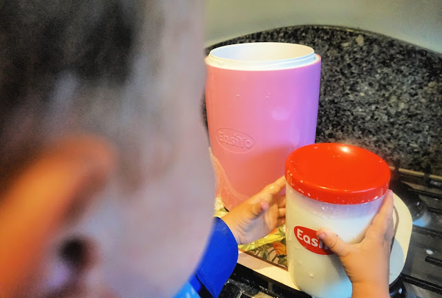 toddler using the easiyo yoghurt maker