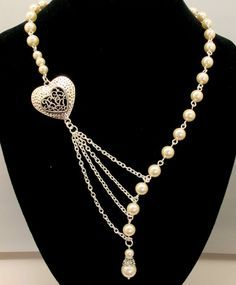https://www.amazon.in/gp/search/ref=as_li_qf_sp_sr_il_tl?ie=UTF8&tag=fashion066e-21&keywords=pearls  with heart gold chain&index=aps&camp=3638&creative=24630&linkCode=xm2&linkId=1da51dbbd930cda2d1cc6aa8a3644c69