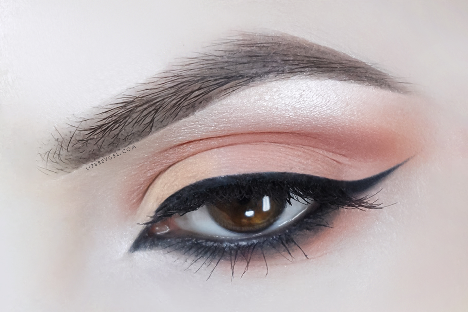 a close up picture of an eye with a soft makeup look