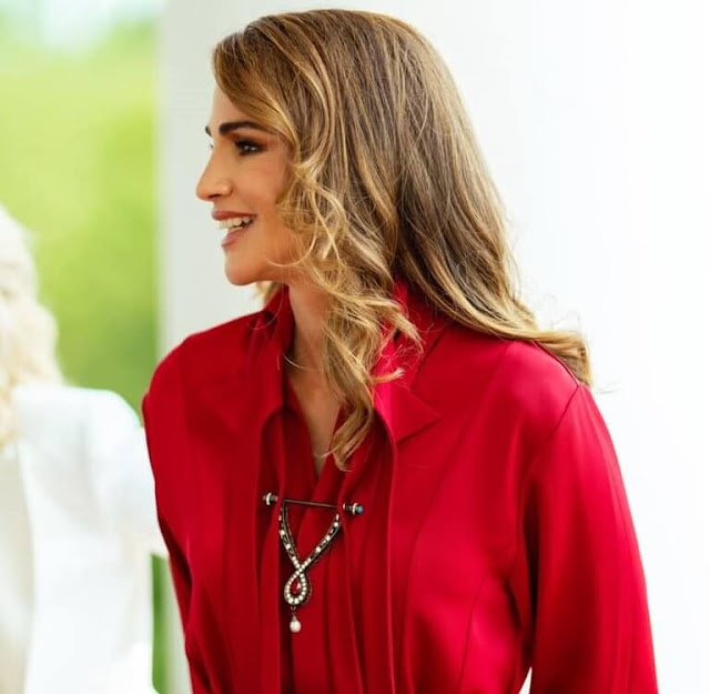Queen Rania wore a red dress by Hussein Bazaza. First Lady Jill Biden wore J'Adior cotton slingback pumps by Dior