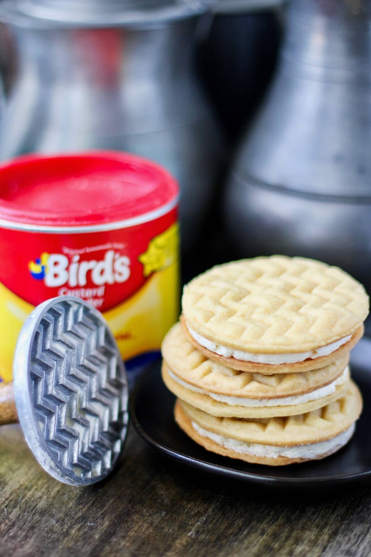 Custard Cream Sandwich Cookies with custard powder and cookie stamp.