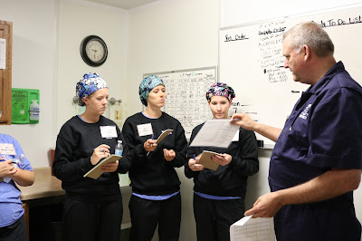 Photo of dietitians learning about pig farming.