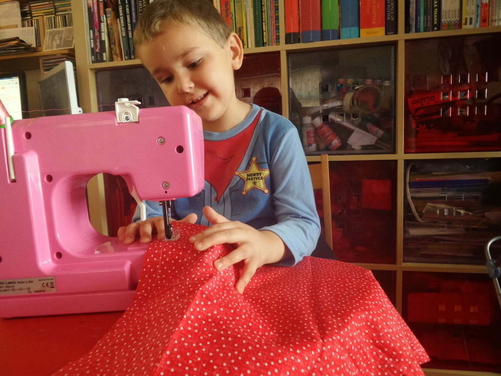 Big Boy happy with his sewing on the sewing machine