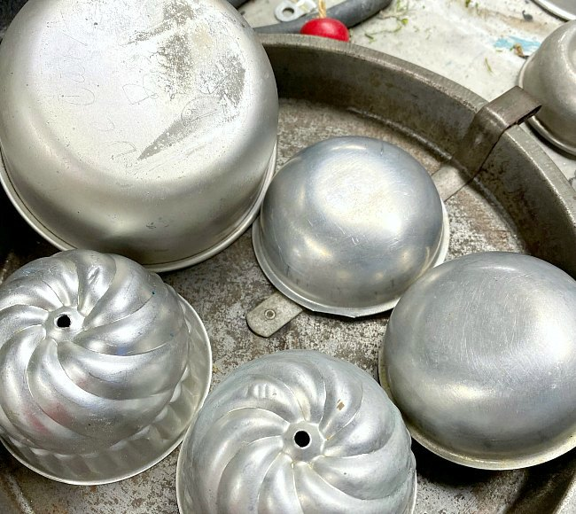 Pile of vintage tins and molds