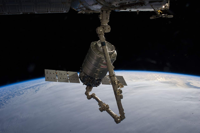 Here-is-a-NASA-image-of-the-Nanossatisfia-the-Orbital-Sciences-Corp-Cygnus-commercial-cargo-craft-on-the-robotic-arm-of-the-ISS.