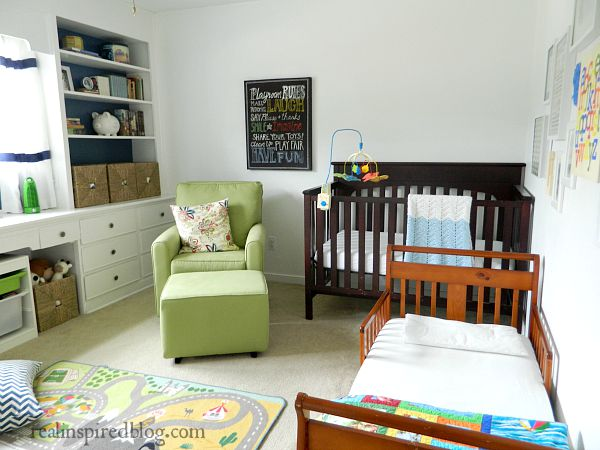 Vintage modern boys' bedroom/nursery using blue, green, and accents of red and yellow.