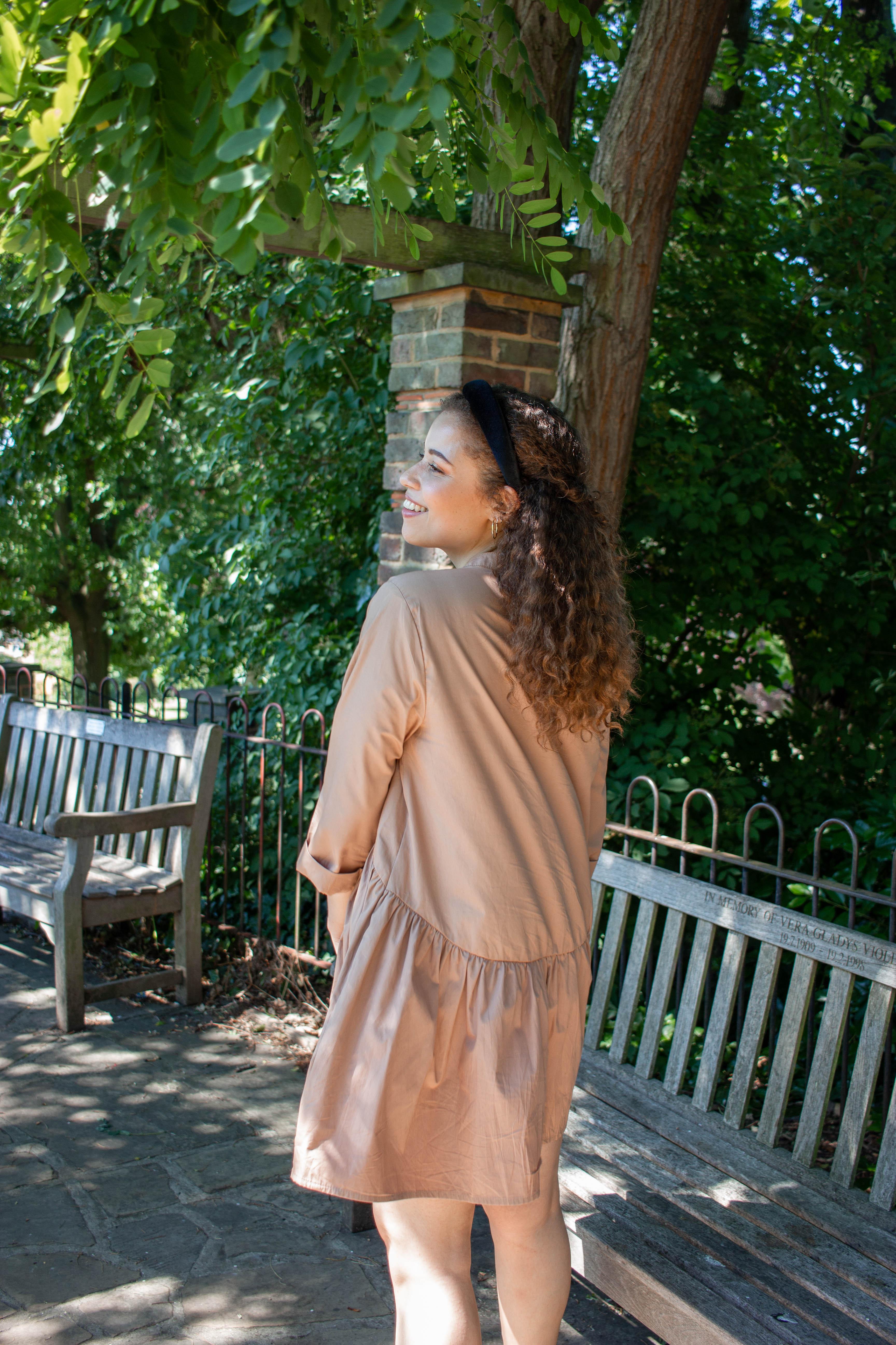 Eboni in Horniman Museum Gardens wearing a brown primark dress