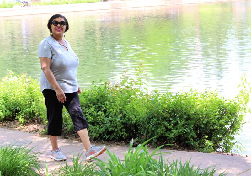 a woman walking at a lake
