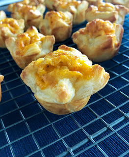 puff pastry with cheese on a baking rack