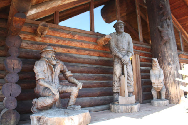Logger and bear woodcarvings greet guests at Camp 18 in Elsie, Oregon