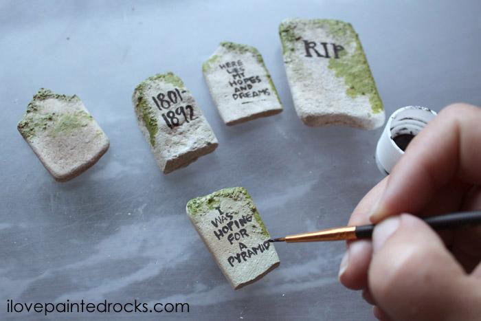 Writing on gravestones painted rocks