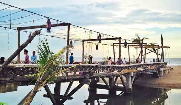 Kayu Putih Beach - Beach With a Backdrop of a Wooden Bridge that Extends Over the Lagoon