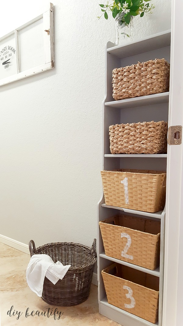 painted cabinet with numbered baskets