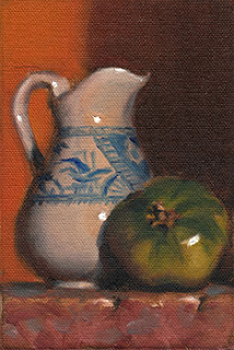 Still life oil painting of a white porcelain jug beside a green tomato