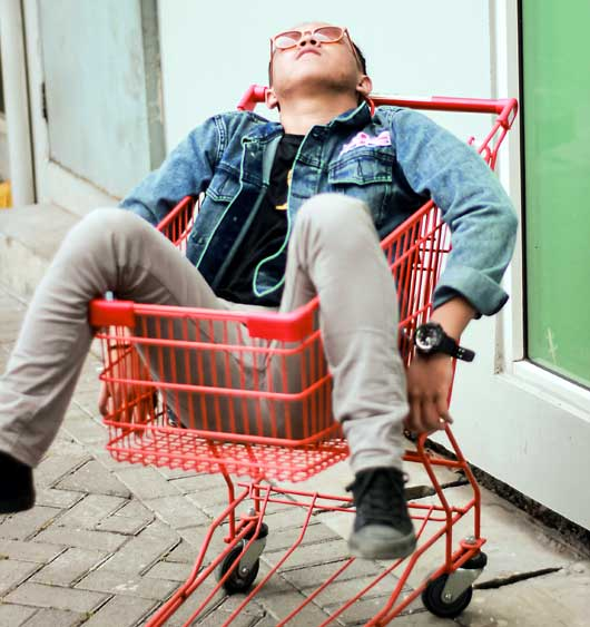 person passed out in grocery cart