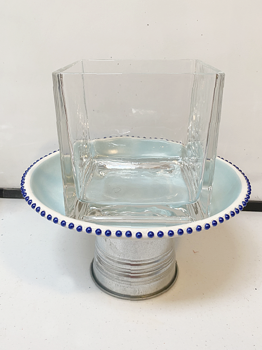 glass dish on top to weight the pedestal dish