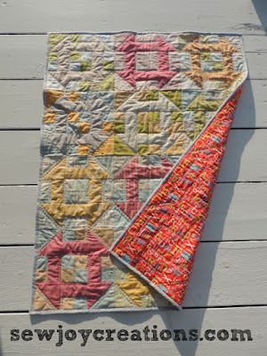 baby quilt with backing showing