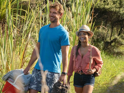 Falling Inn Love 2019 movie still where Adam Demo's character Jake and Christina Milian's character Gabriela take a hike and have a picnic together