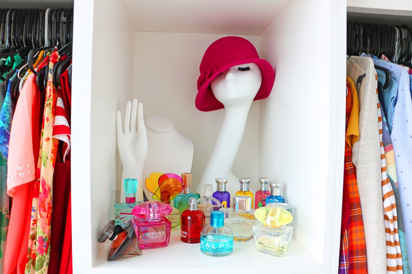Display pretty perfume bottles as art in your closet!