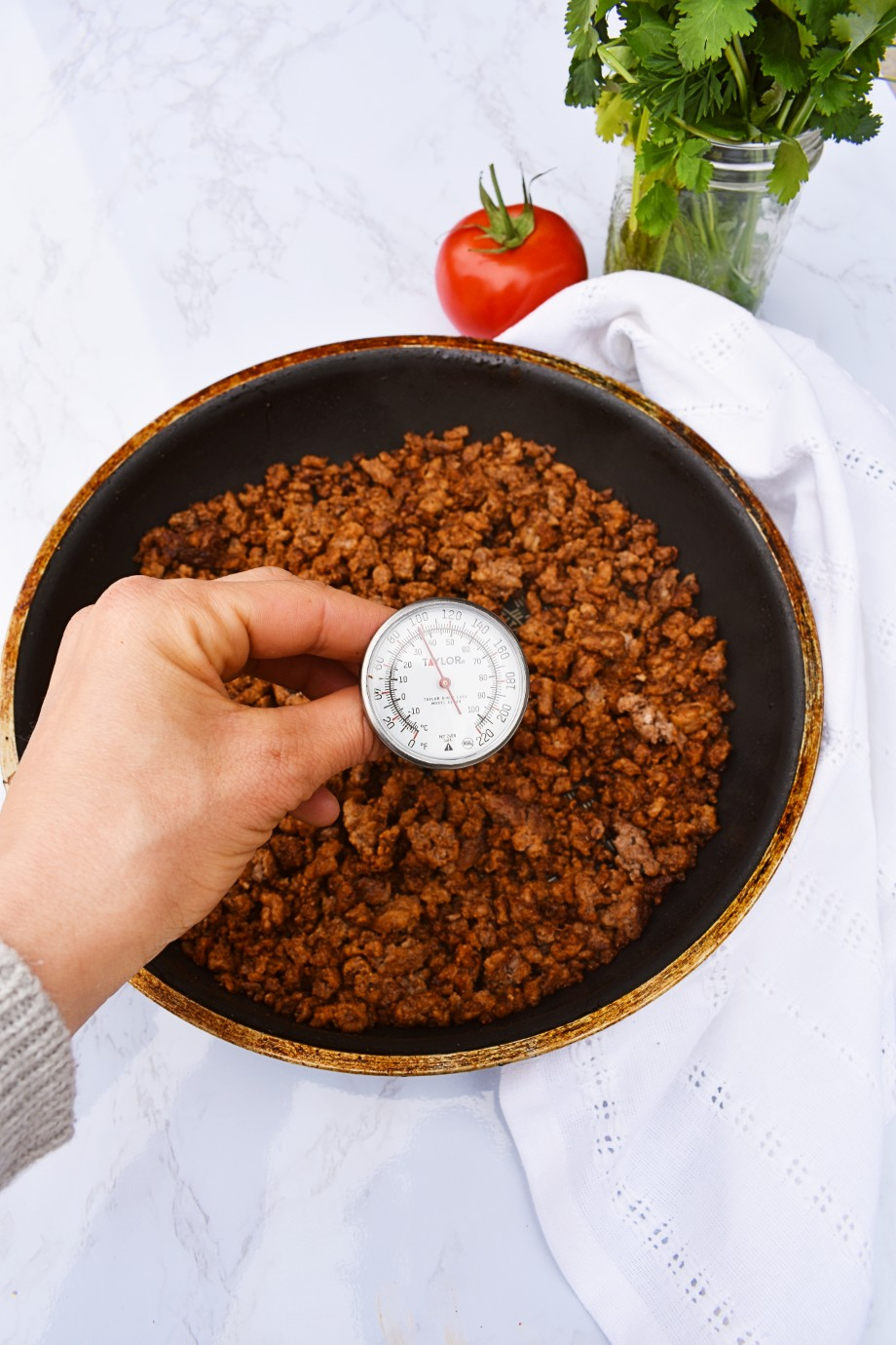 taking temperature of ground beef