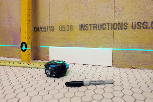 first tile shower wall installation renovation layout laser level