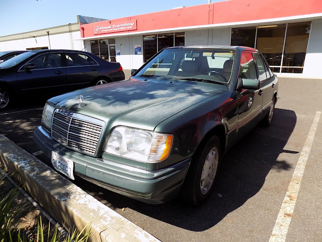 Faded Mercedes Benz before complete car paint job at Almost Everything Auto Body.
